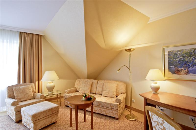 Hotel room with seating in beige