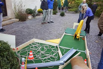 Woman playing miniature golf on a self-built course