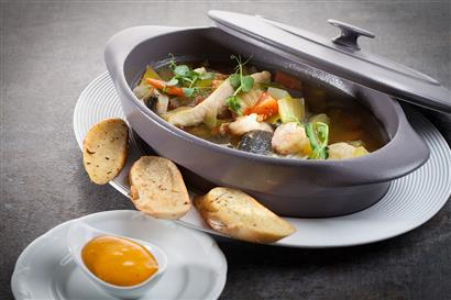 Bouillabaisse with garlic bread in detail