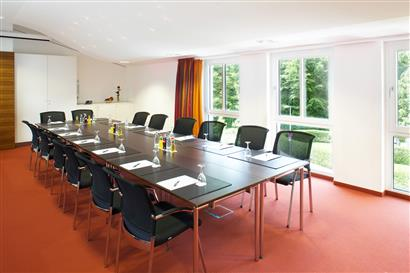 Modern conference room with tables and chairs
