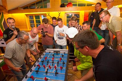 Men play table football