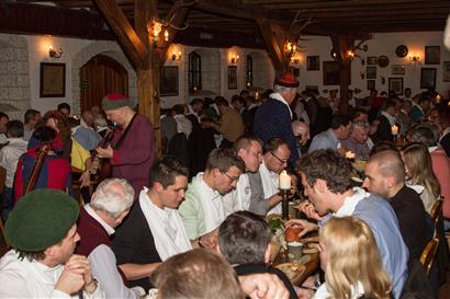 Men and women at a knight's dinner