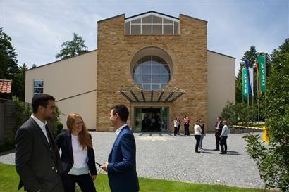 Exterior view of the conference centre in Bad Wörishofen with people in the front
