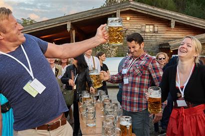 Men and women raising a beer jug